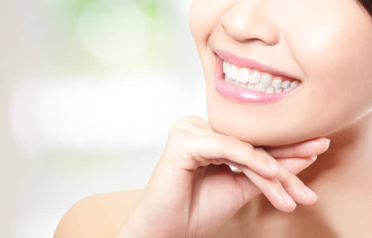 Woman smiling with healthy white teeth - Brentwood Dental