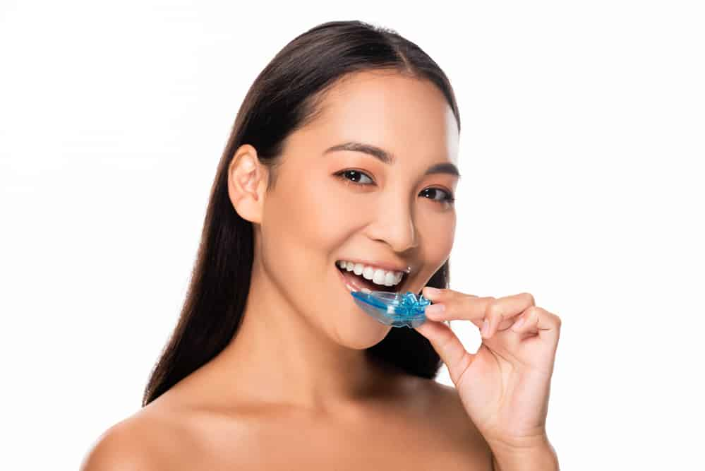 Lady with mouthguard smiling - Brentwood Dental