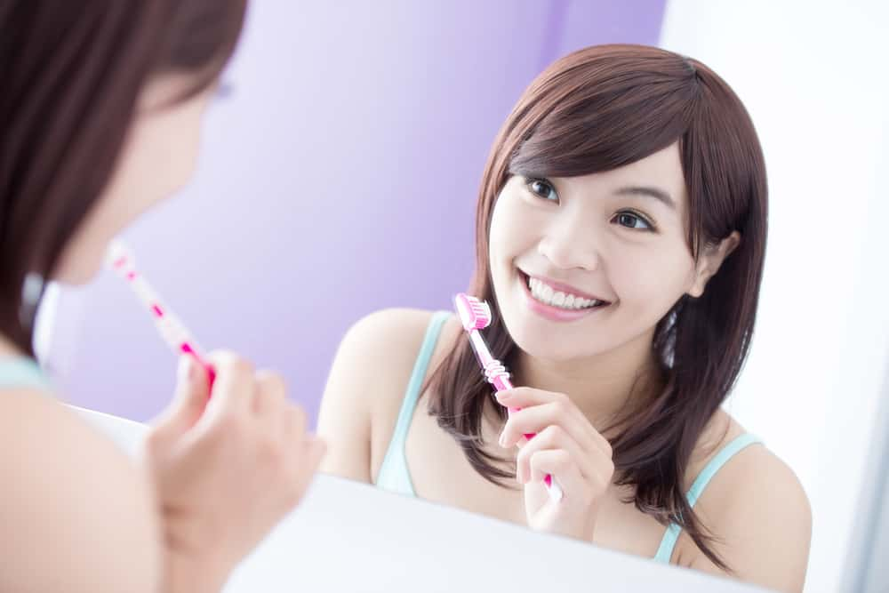 Lady admiring her recently brushed and clean teeth - Brentwood Dental