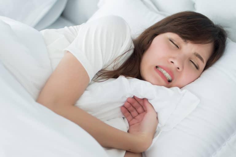 Lady sleeping and grinding teeth - Brentwood Dental